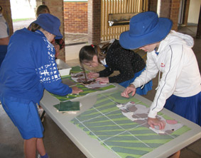Students working on a community mosaic