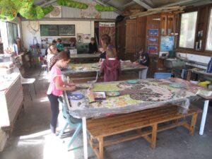 river school community mosaic students working
