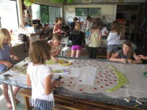 river school community mosaic students at work