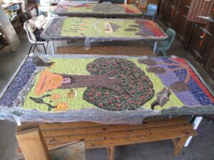 river school community mosaic pieces laid ready for installation